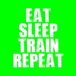 eat sleep train repeat white heat transfer on a green t-shirt